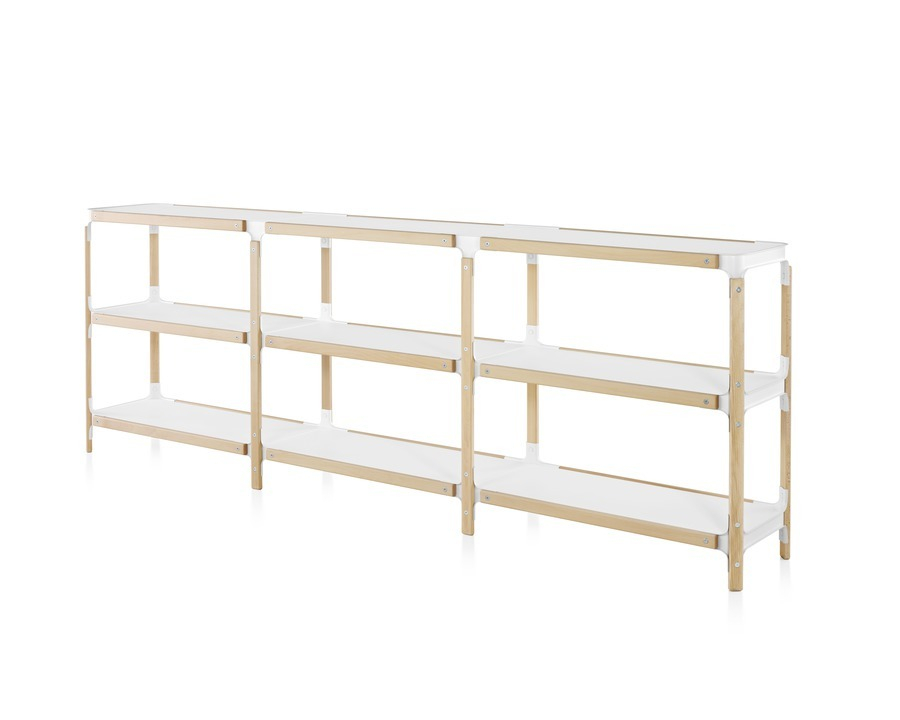 Angled view of a Magis Steelwood modular shelving system with three rows of white shelves and a wood frame.