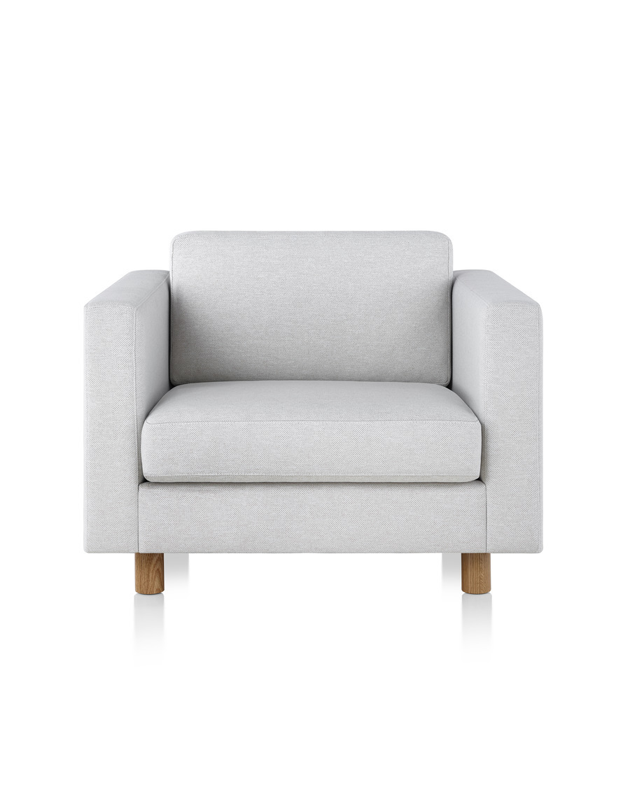 A Lispenard lounge chair with light wood legs and light gray upholstery, viewed from the front