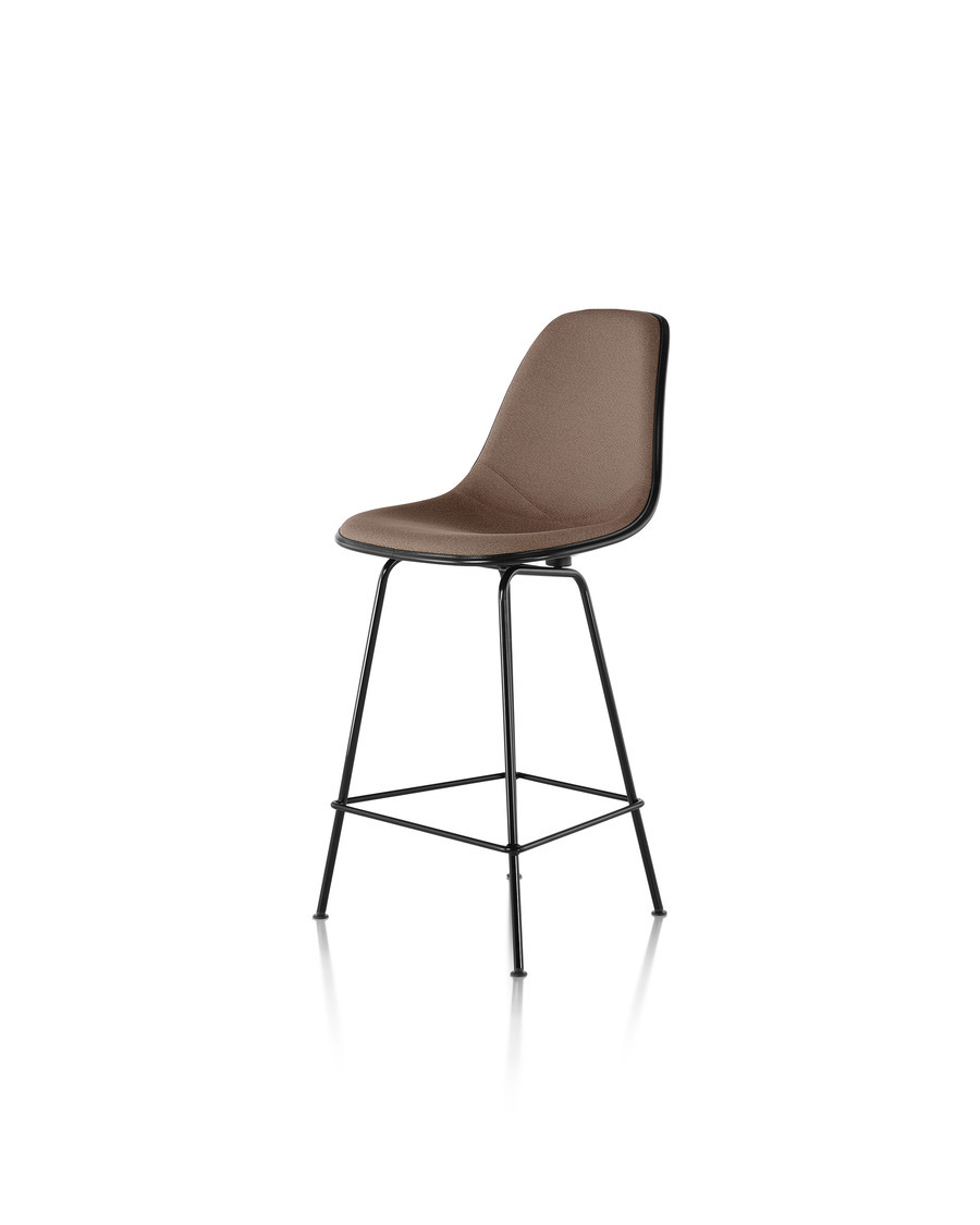 Black Eames Molded Fiberglass Stool with brown upholstery, viewed from a 45-degree angle.