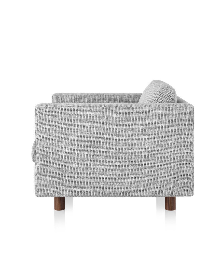 A gray Lispenard lounge chair with dark wooden legs and fabric upholstery, viewed from the side