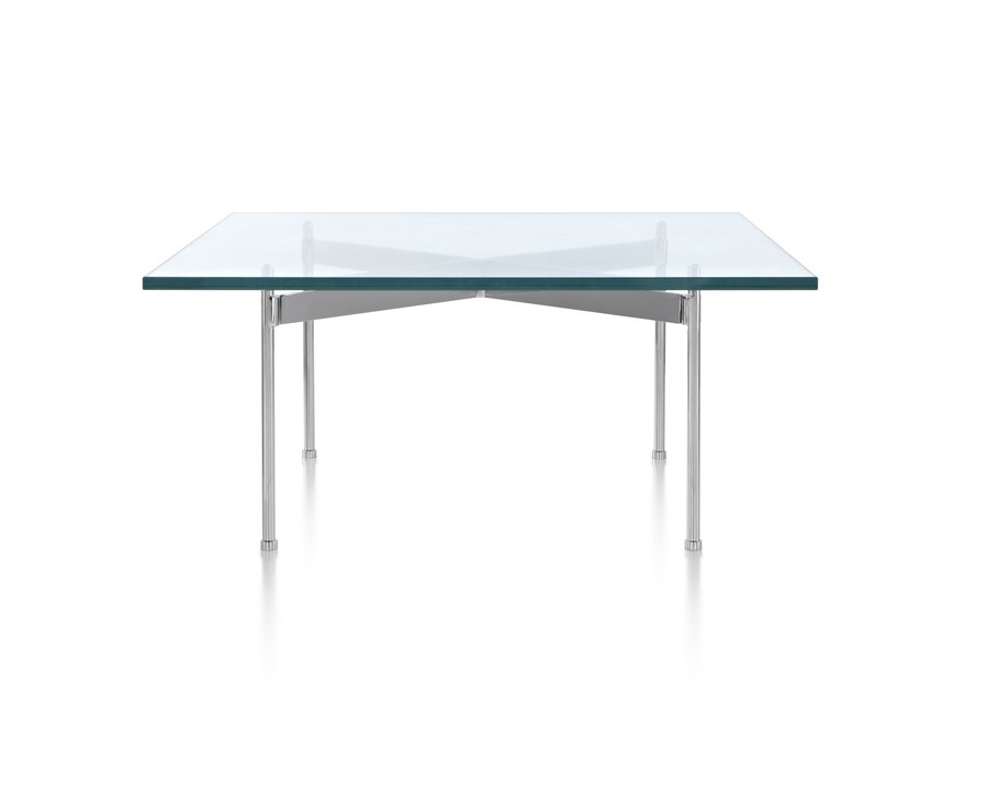 A glass-top Claw Table with a rectangular surface and four metal legs.