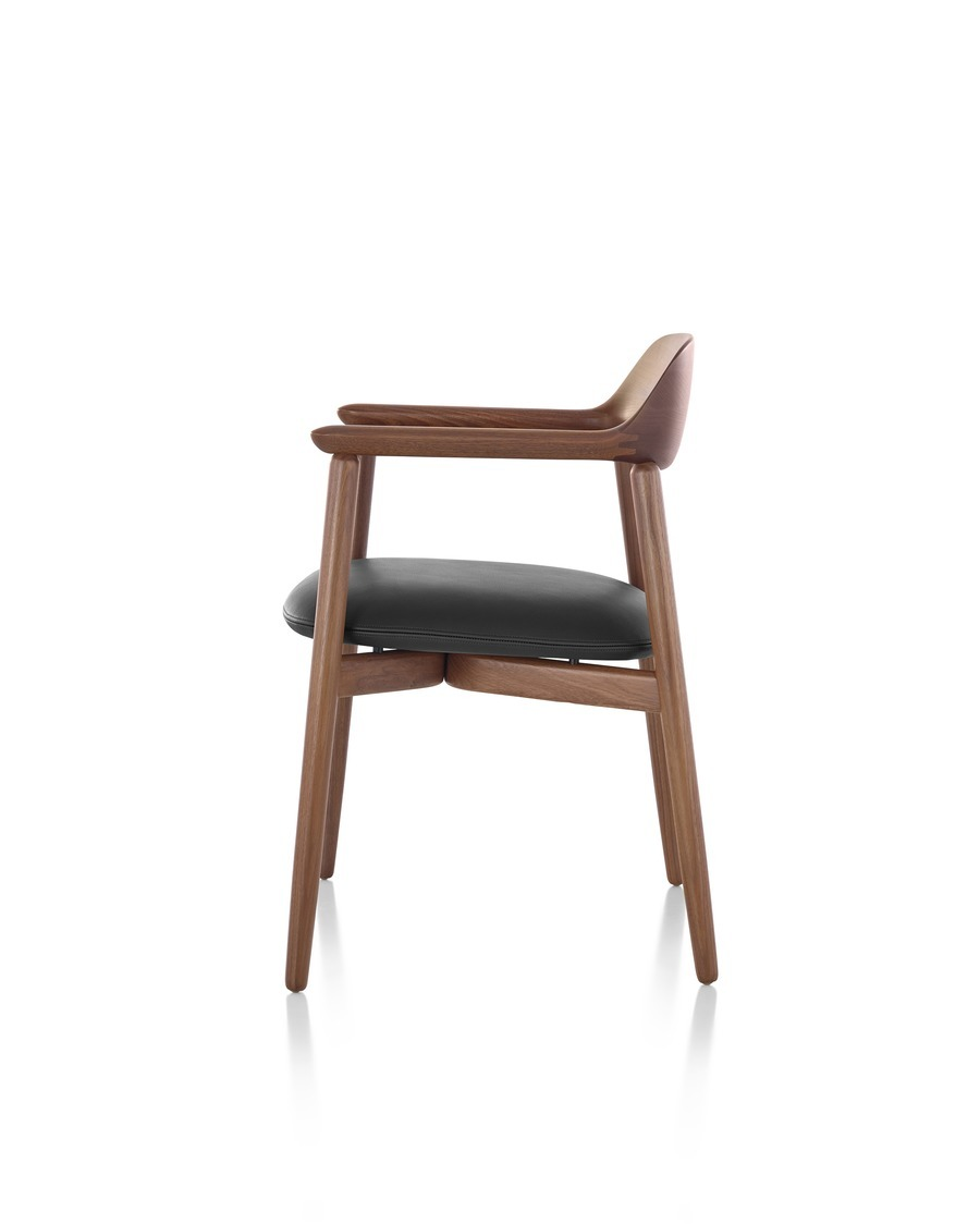 Crosshatch Side Chair with a dark finish and black seat cushion, viewed from the side