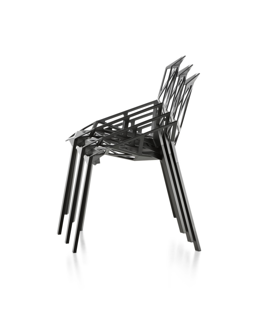 Profile view of four Magis Chair_One side chairs, stacked four-high.