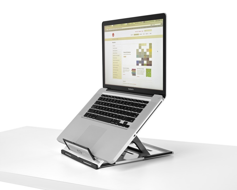 An open notebook computer positioned at a comfortable viewing angle with the help of Lapjack Mobile Technology Support