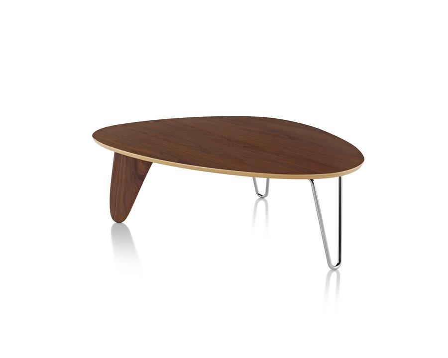 A Noguchi Rudder Table with a walnut finish.