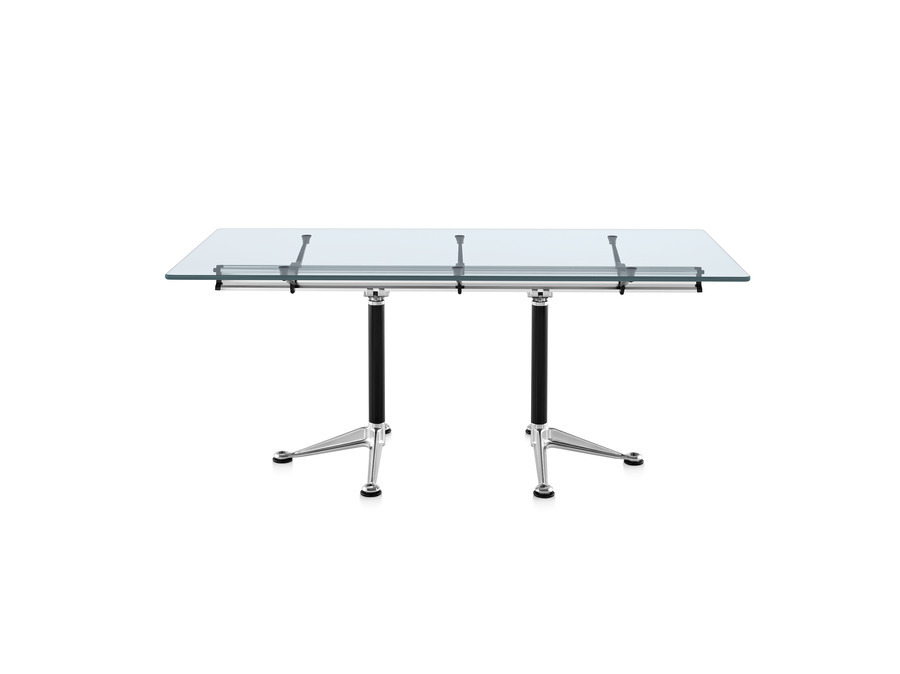 Square Burdick table with a glass top, black leg columns, and aluminum bases viewed from the long side