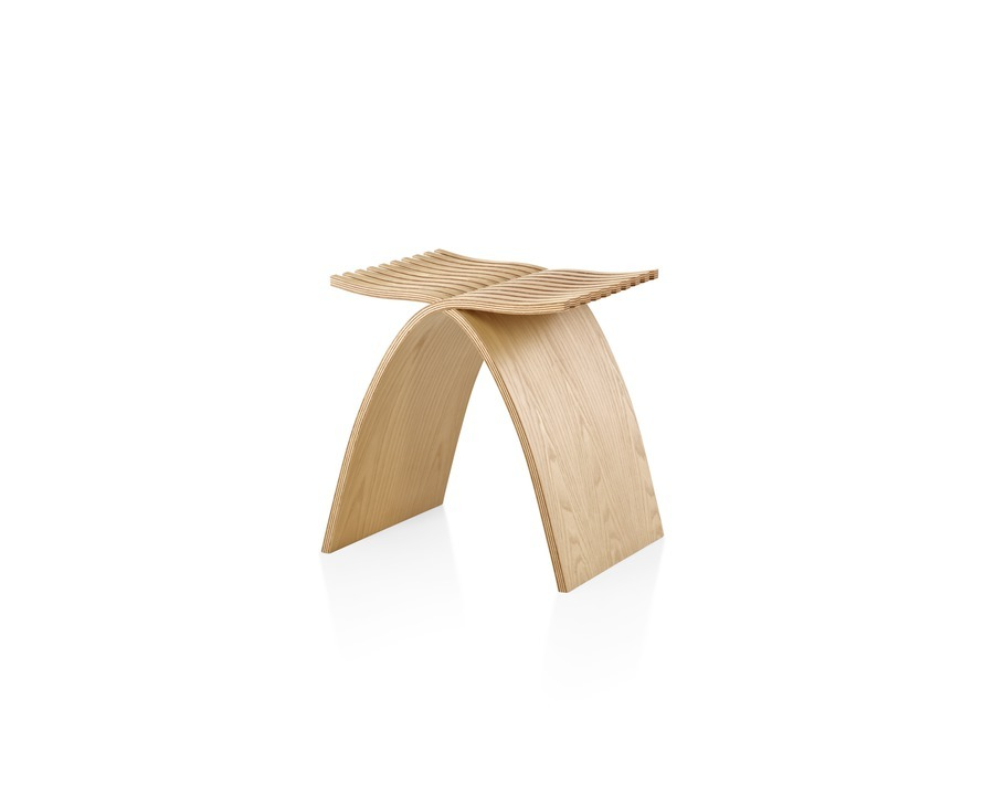 A molded plywood Capelli Stool with a light ash veneer, viewed from the front at an angle