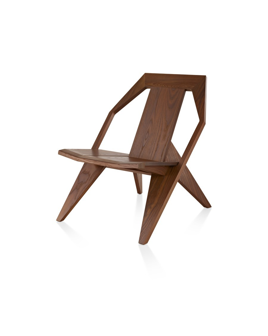 An angled view of a wood Mattiazzi Medici outdoor chair in a medium finish.