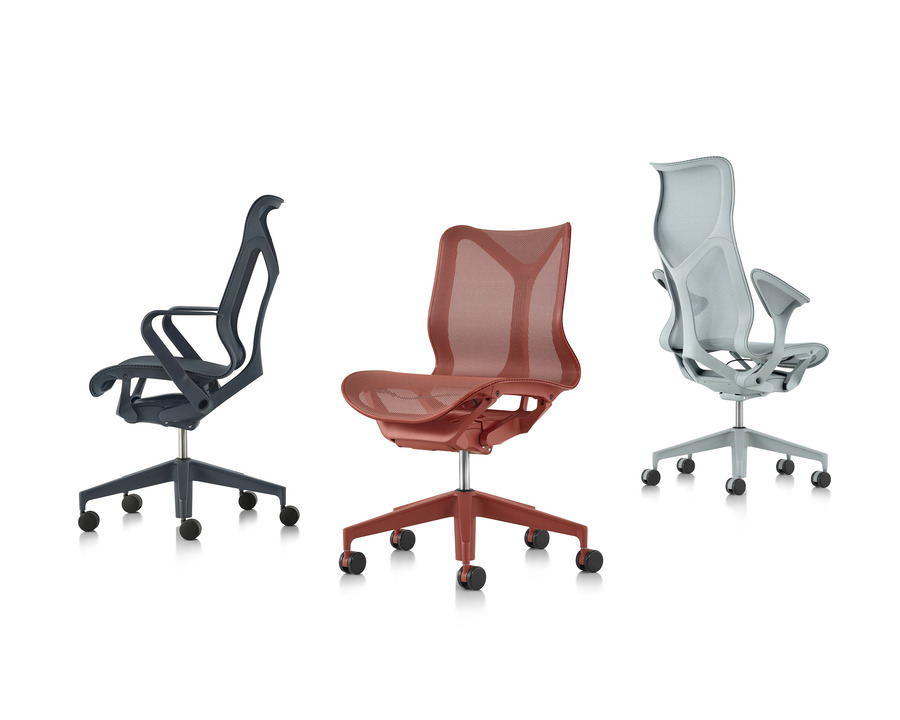 Grouping of a black, red, and light blue Cosm office chairs of various shapes and back heights, facing varying directions