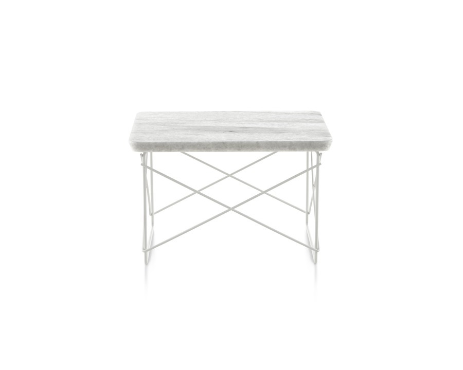 A rectangular Eames Wire Base Low outdoor table with a marble top and white wire base.