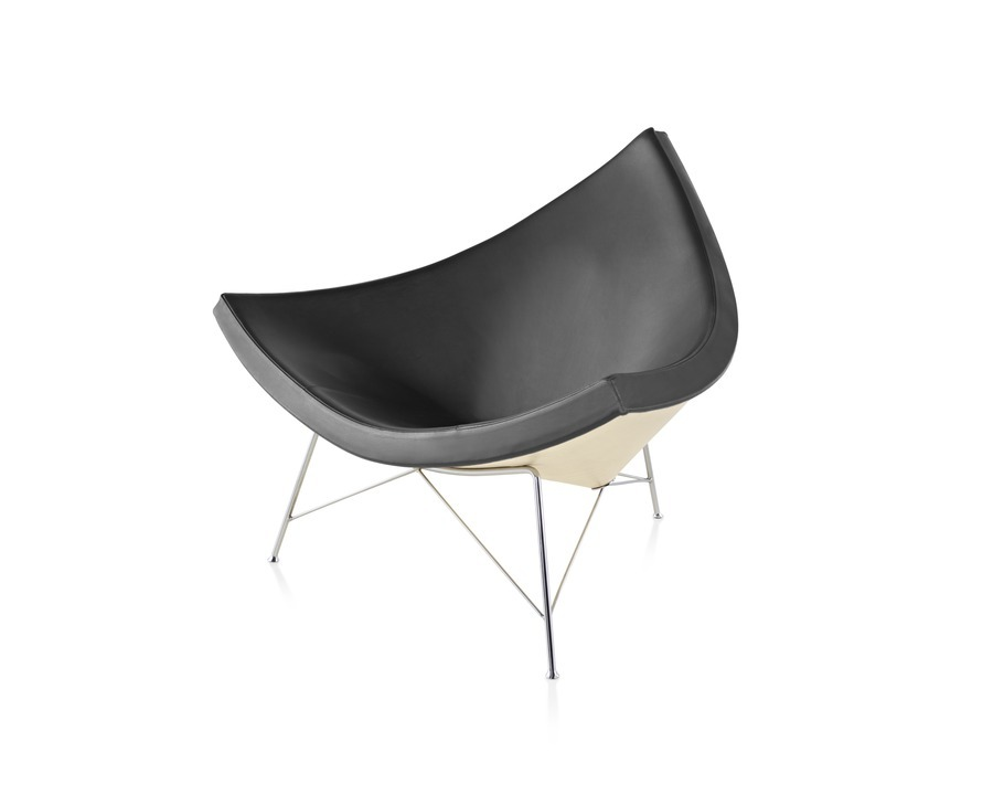 A black leather Nelson Coconut Lounge Chair, viewed from a 45-degree angle.