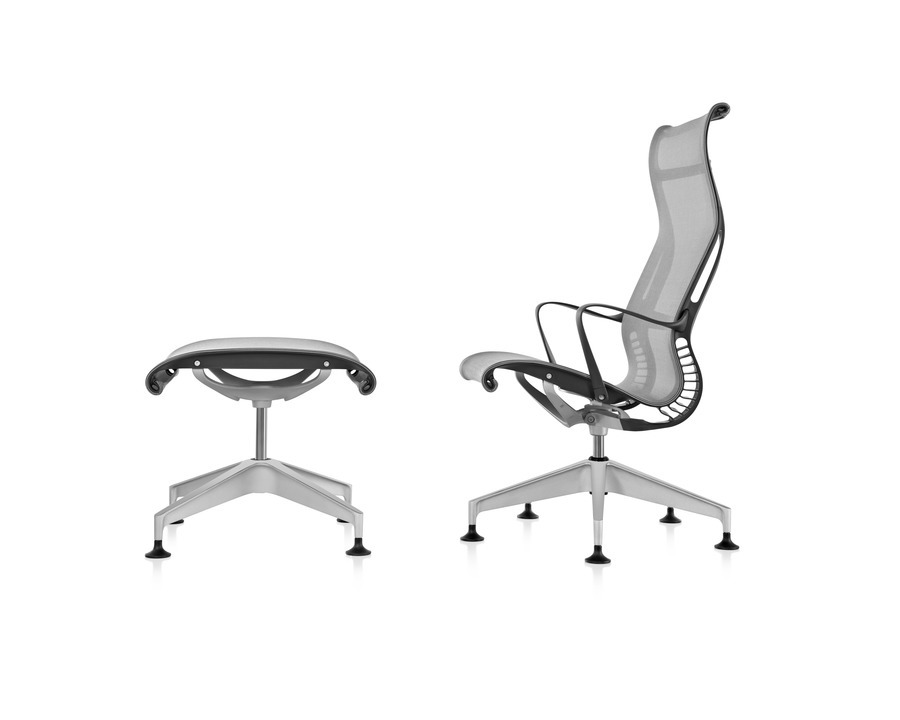 Profile view of a black Setu Lounge Chair and Ottoman, showing the chair's ergonomically contoured back and Kinematic Spine.