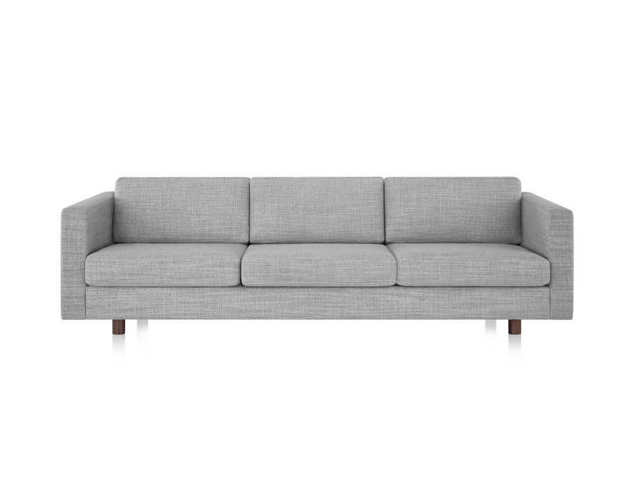 A Lispenard sofa with gray fabric upholstery and walnut wood legs, viewed from the front.