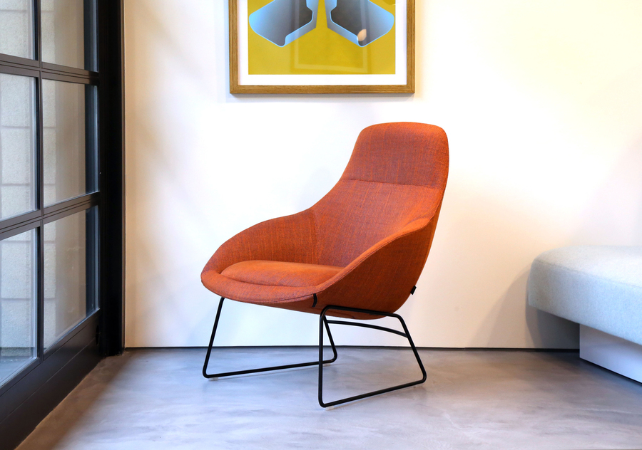 A naughtone Always Lounge Chair with a back steel sled base and patterned red upholstery, viewed at an angle.