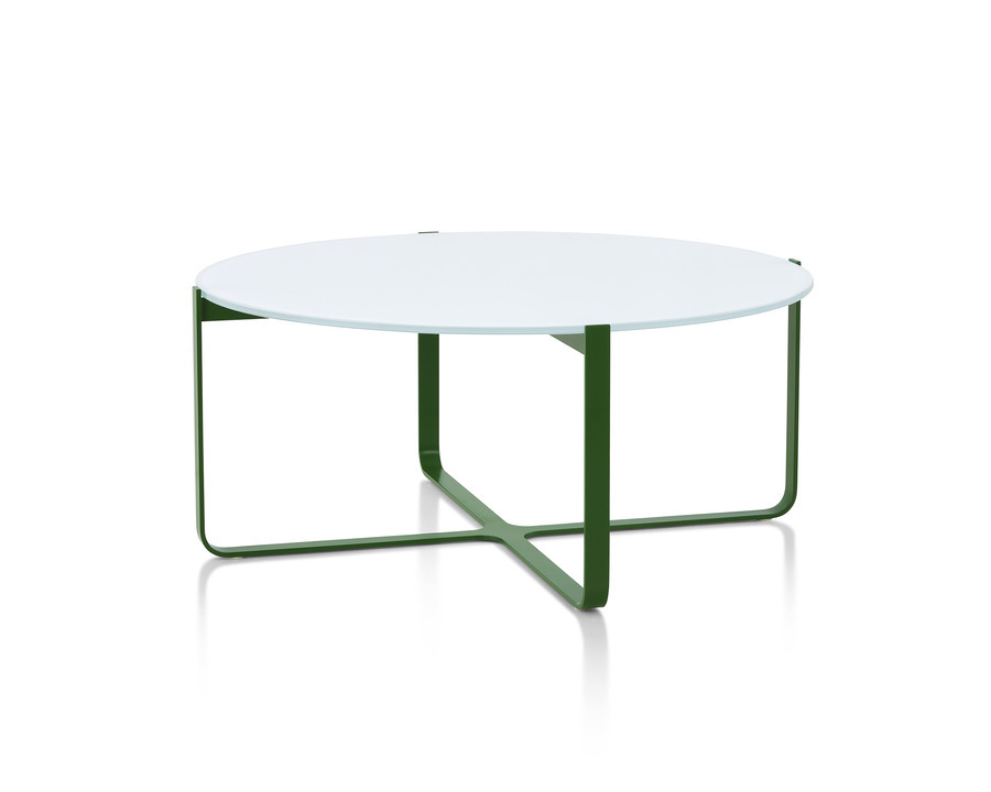 A dark green, round Trace Coffee Table with glass top, viewed from the side