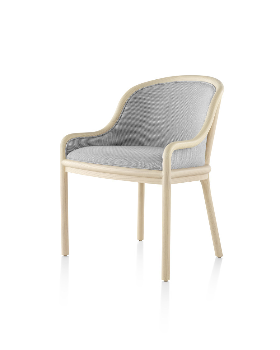 Landmark Chair with light gray upholstery and a light wood frame, viewed from the front at a 45 degree angle