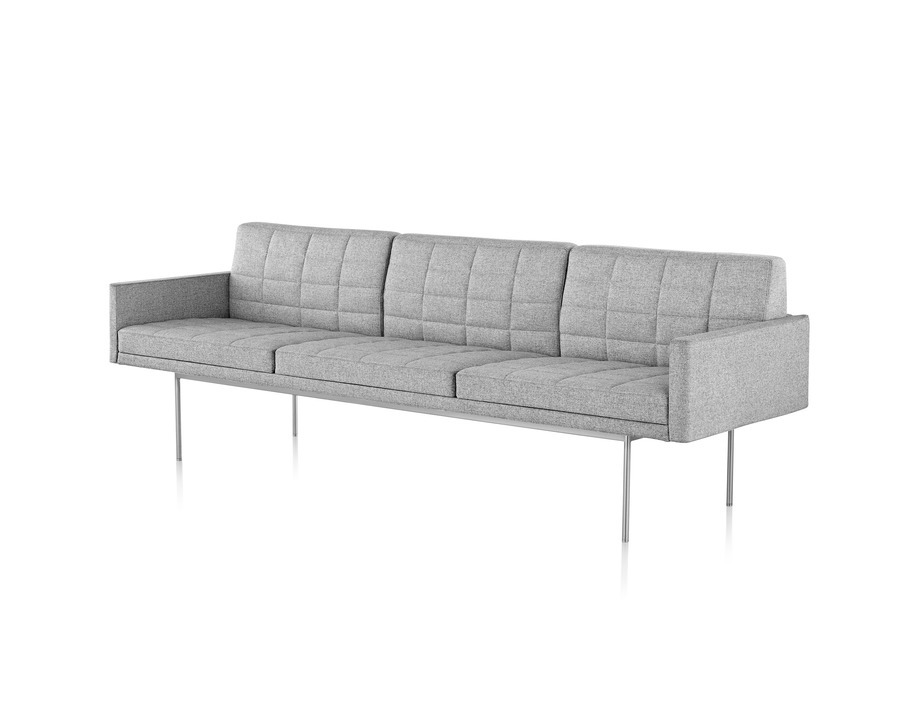 A Tuxedo Component Sofa with no arms, a metal base, and quilted upholstery.