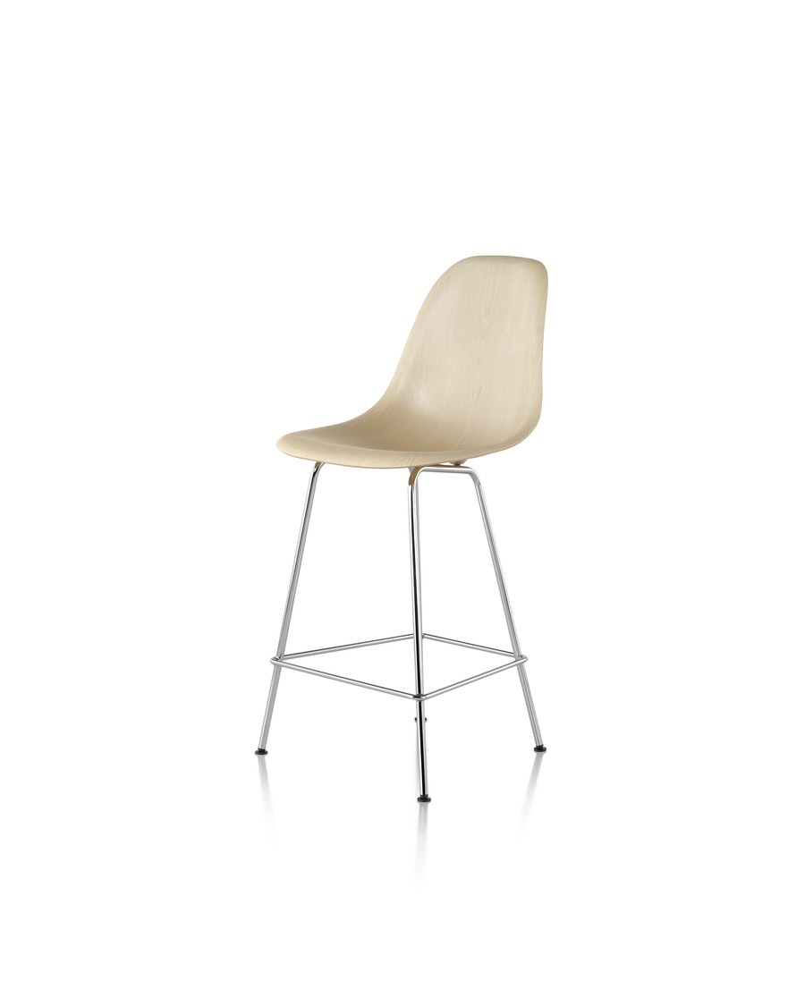 Eames Molded Wood Stool with a light finish and silver legs, viewed from the front at an angle