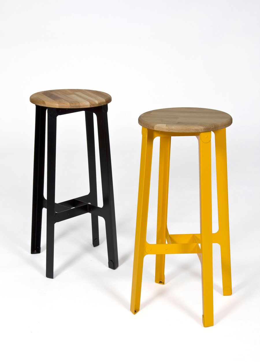 Two bar height naughtone Construct Stools, one black and one yellow.