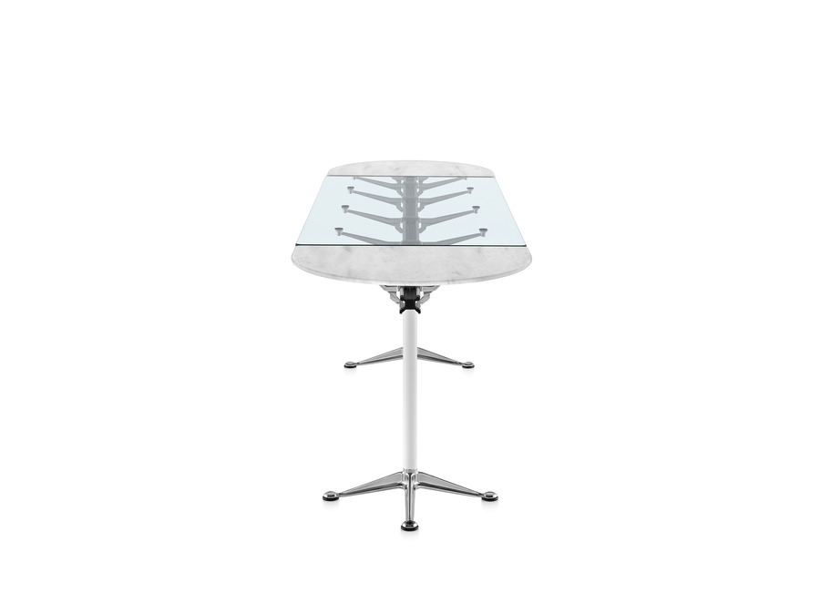 Oval Burdick table with a glass and stone top, white leg columns, and aluminum bases viewed from the narrow side