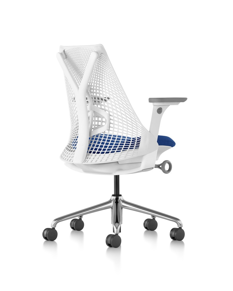 Rear view of a white Sayl office chair with a suspension back and blue upholstered seat, on wheels and with armrests