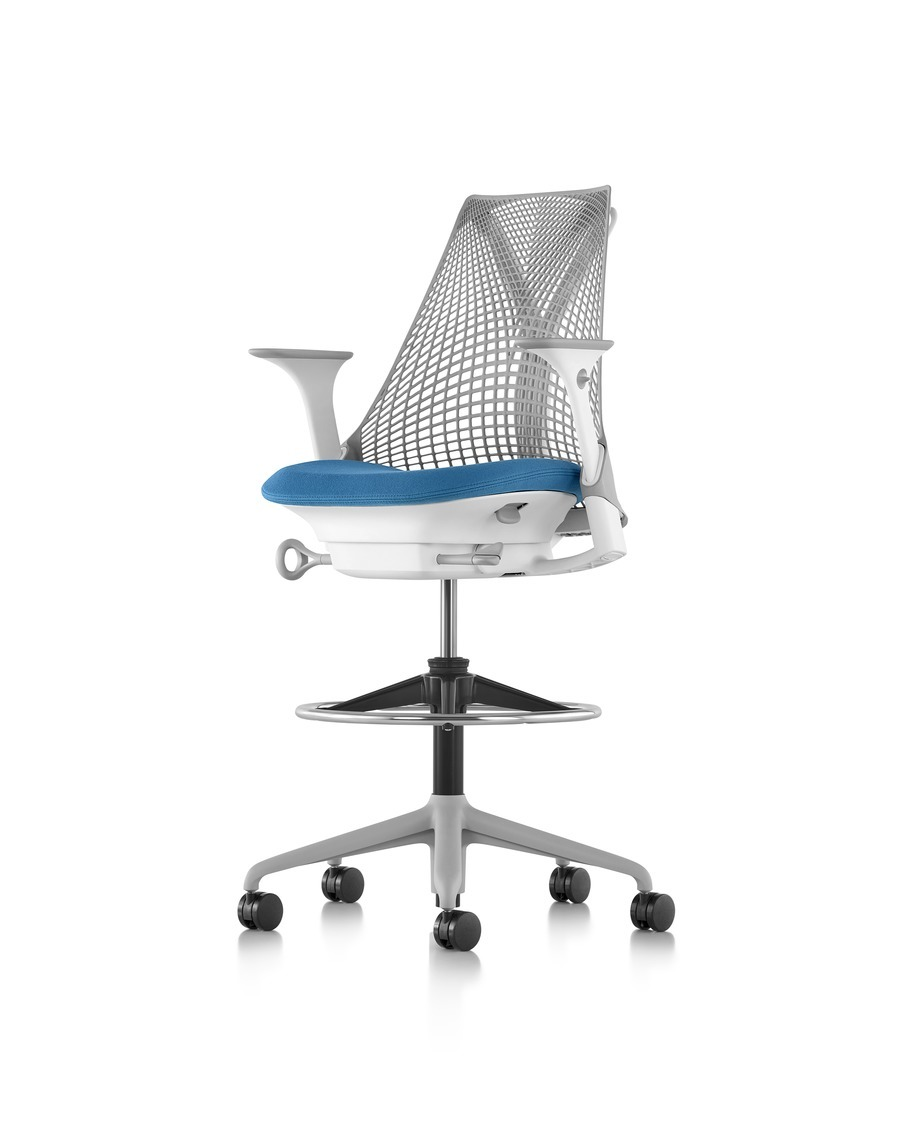 Light gray Sayl Stool with a blue seat, viewed from a 45-degree angle.