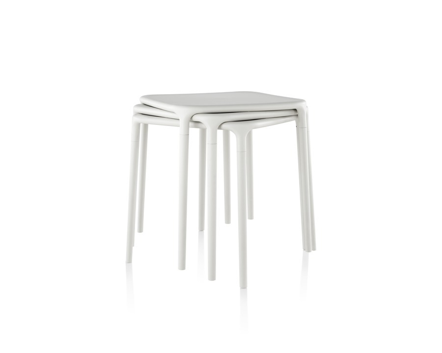 White Magis Air Tables stacked on top of one another
