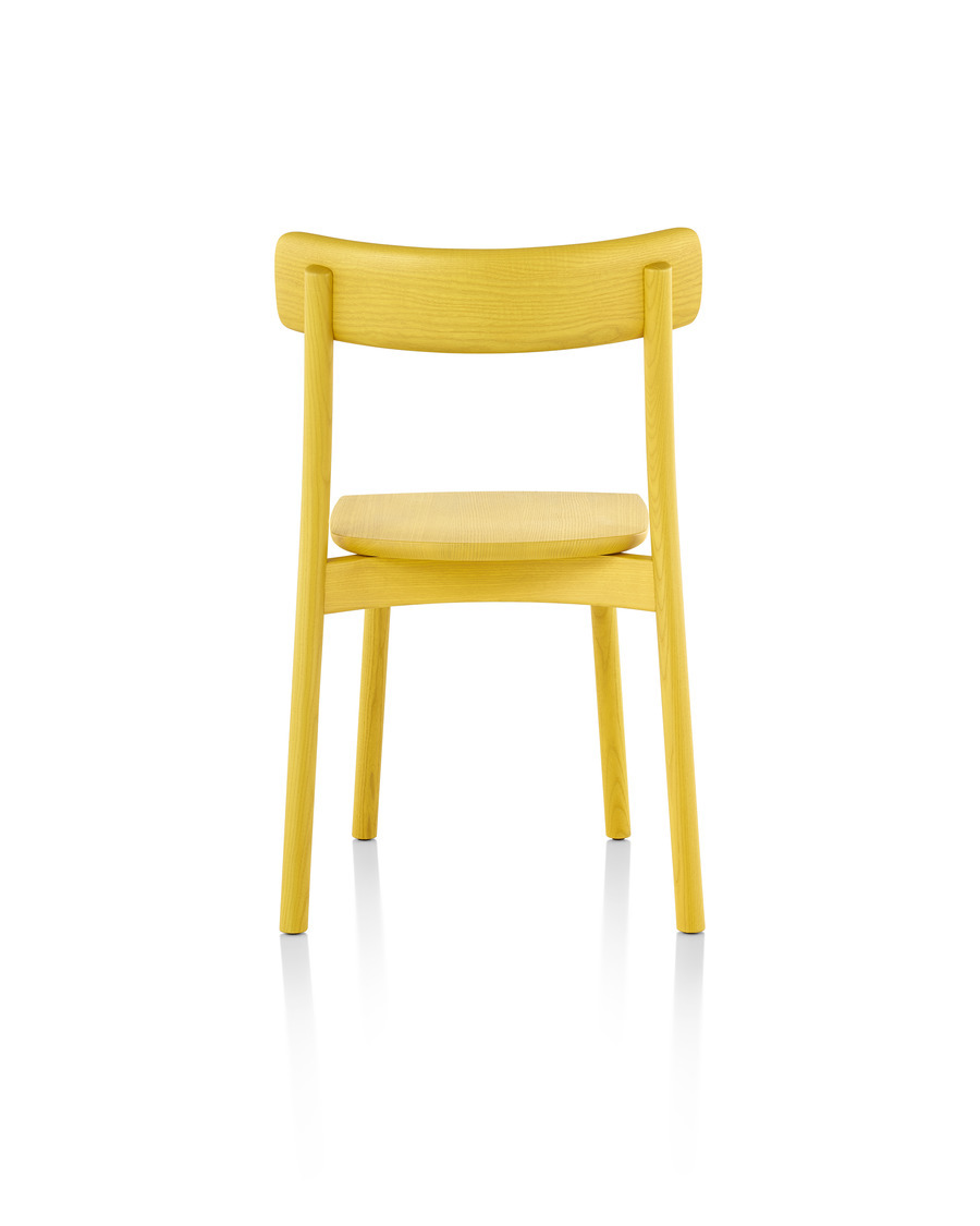 Rear view of an armless Mattiazzi Chiaro stackable side chair with a yellow finish.