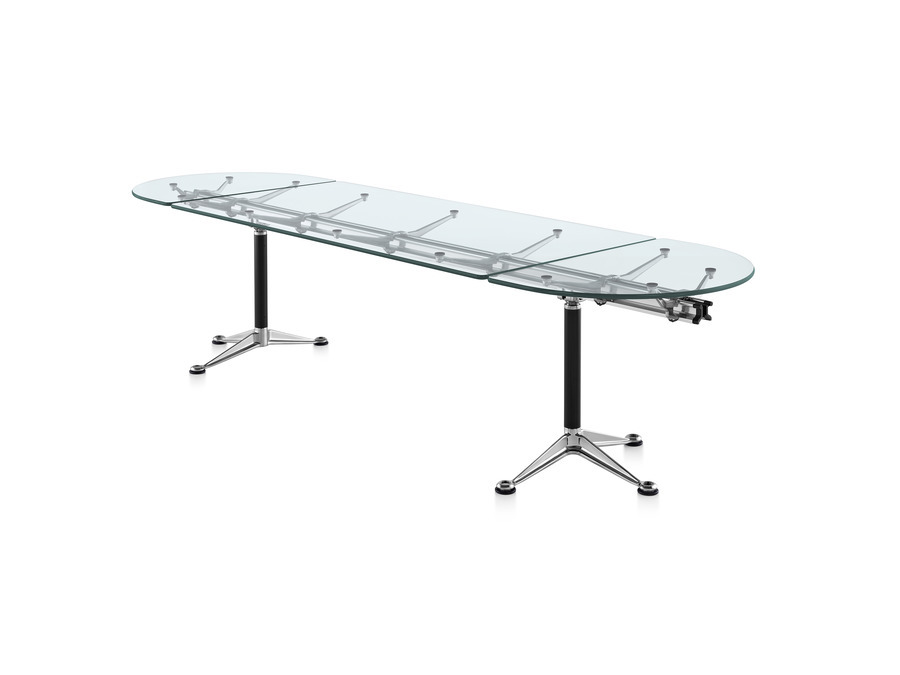 Sophisticated, distinctive, highly functional, the Burdick Table is built around a central aluminum beam. Clear glass surface showcases this understructure