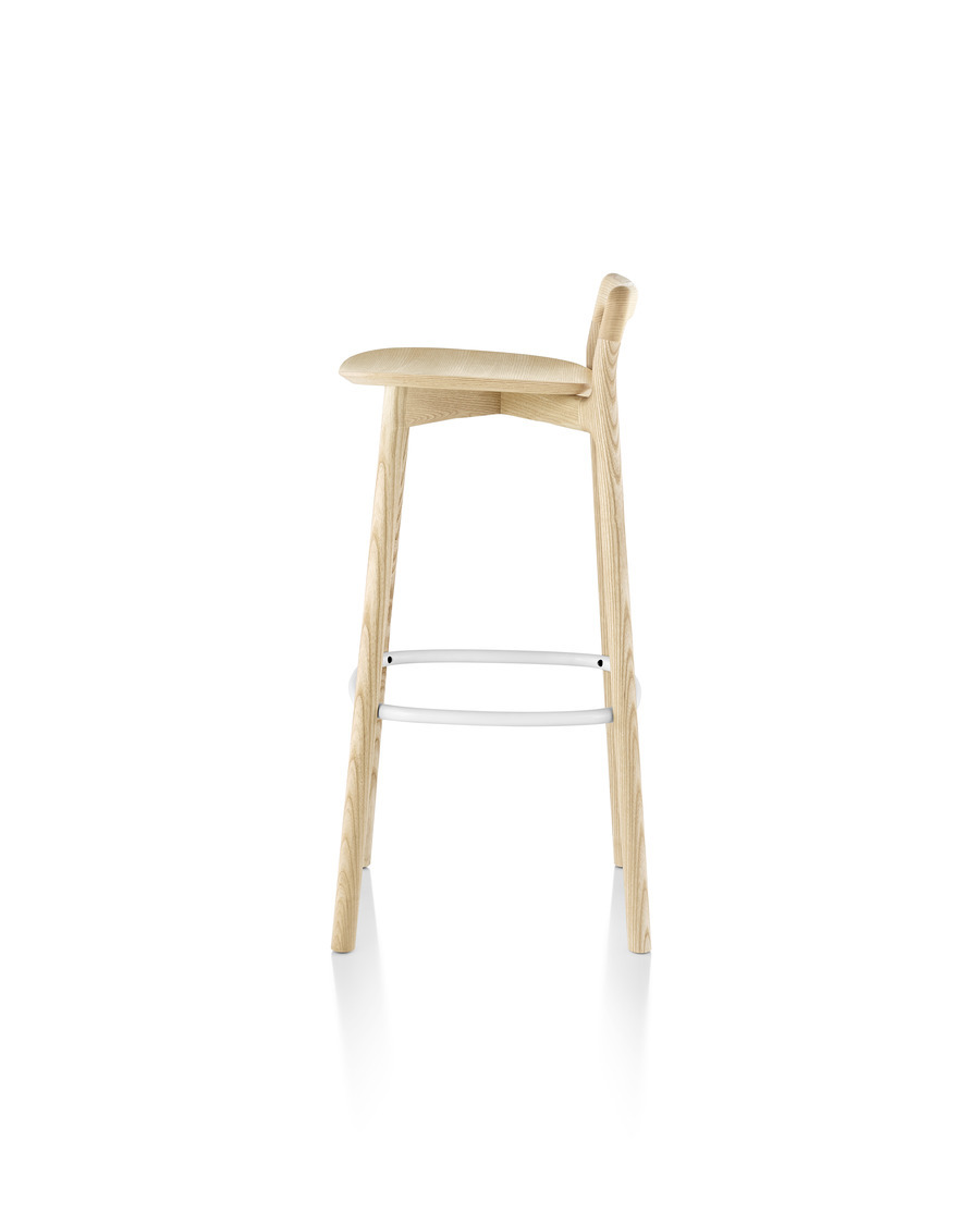 Profile view of a Mattiazzi Branca Stool with a light wood finish and white footrest.