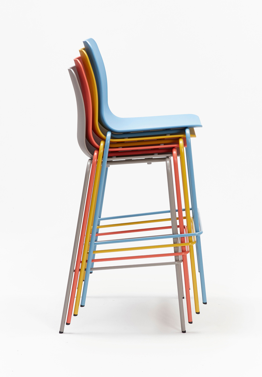 A tan, orange, yellow, and blue Polly Stool stacked upon one another, viewed from the side.
