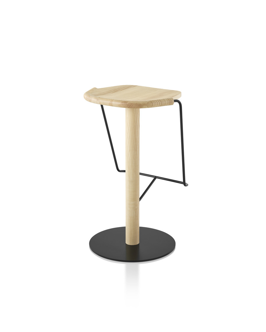 Mattiazzi Uncino Stool with black frame and natural ash seat, viewed from the back at an angle.
