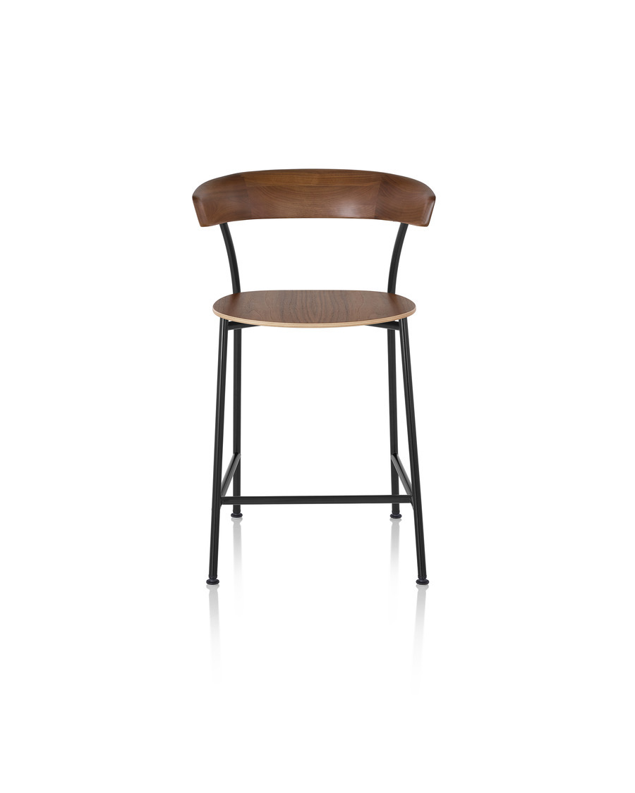 Leeway Stool with black metal base and dark brown wood seat and backrest, one viewed from the front
