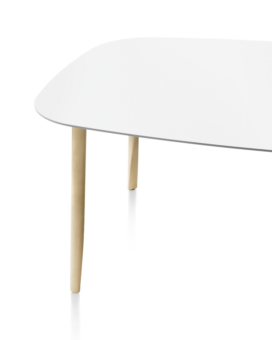 Close up of corner of Mattiazzi Branca table, white top with wood based