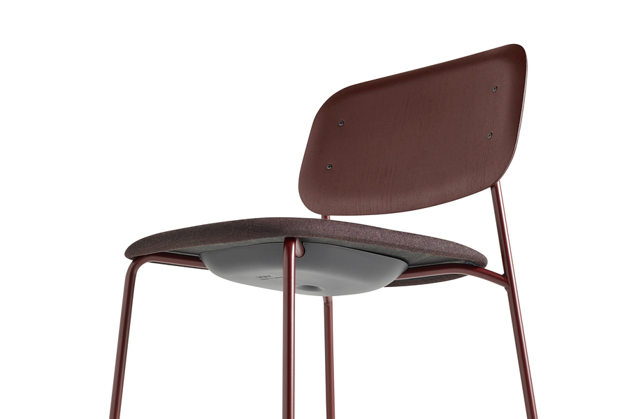 Close-up of the underside of a red Soft Edge Chair.