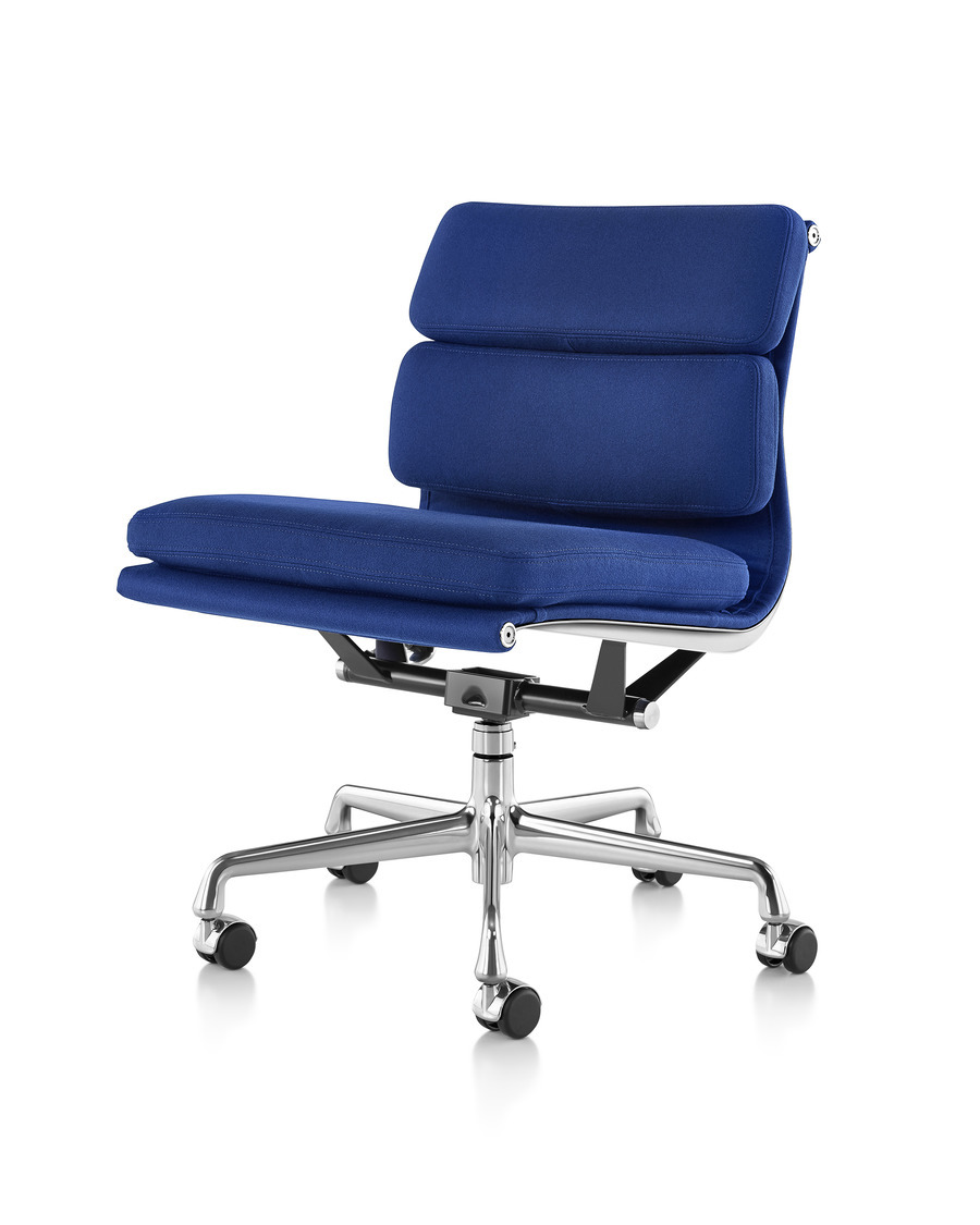Front angled view of a blue upholstered Eames Soft Pad Chair, armless and on wheels