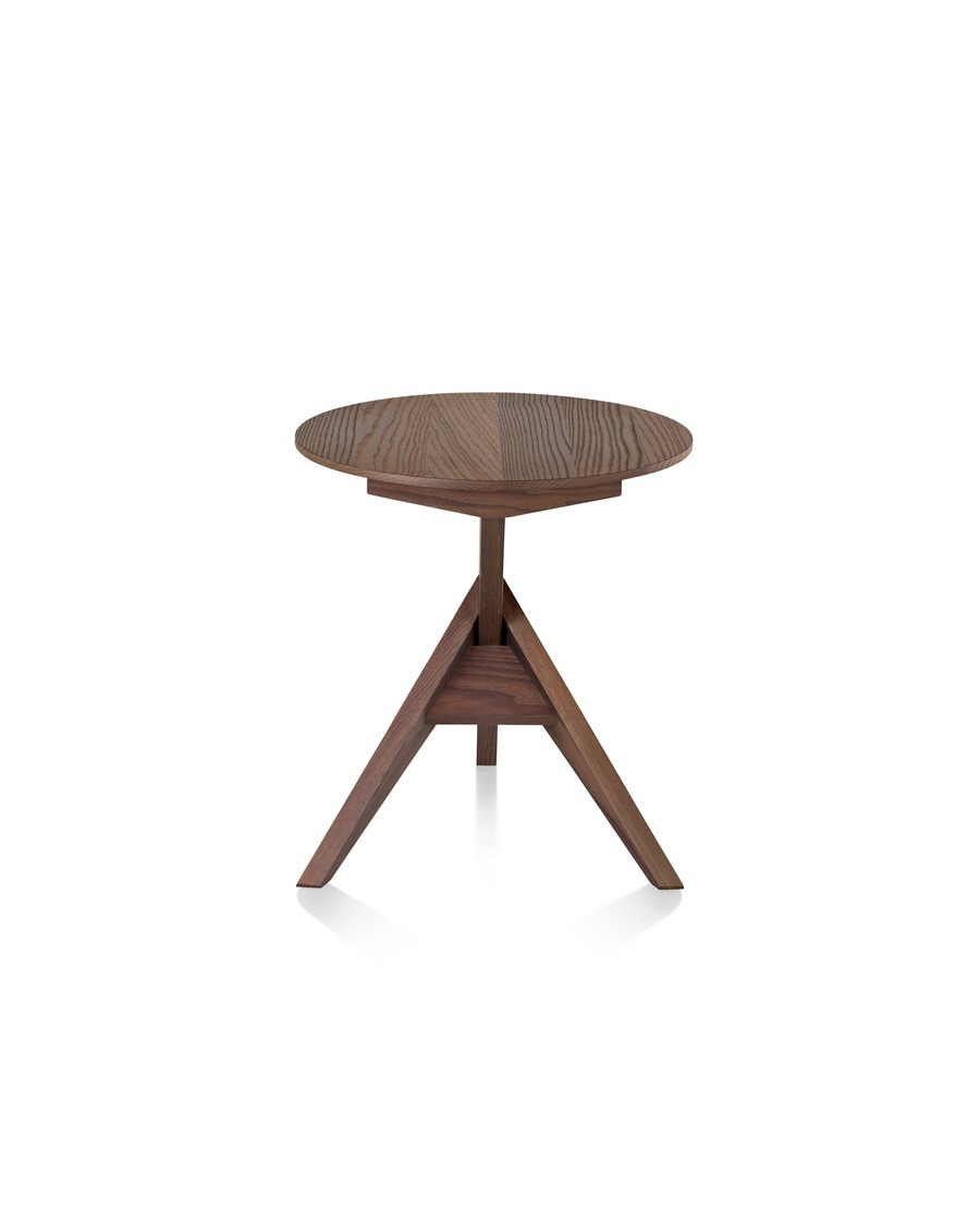 A Mattiazzi Medici outdoor table with a round top and angular tripod base, viewed from the rear.