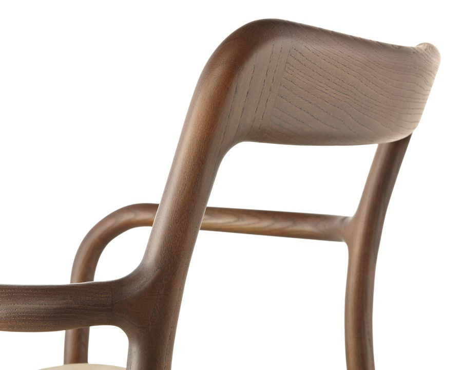 Close up of back of Mattiazzi Branca chair in medium wood finish