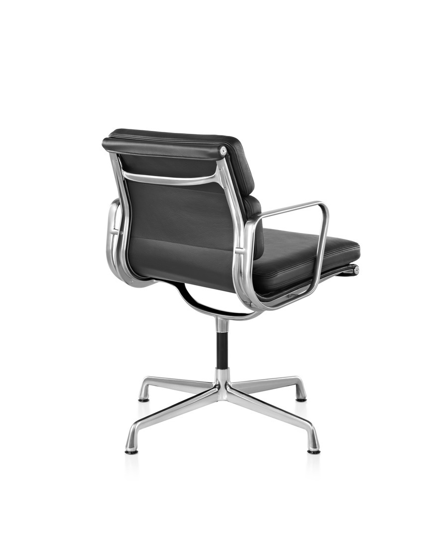 Angled rear view of Eames Soft Pad Side Chair in black leather and polished aluminum base and armrests