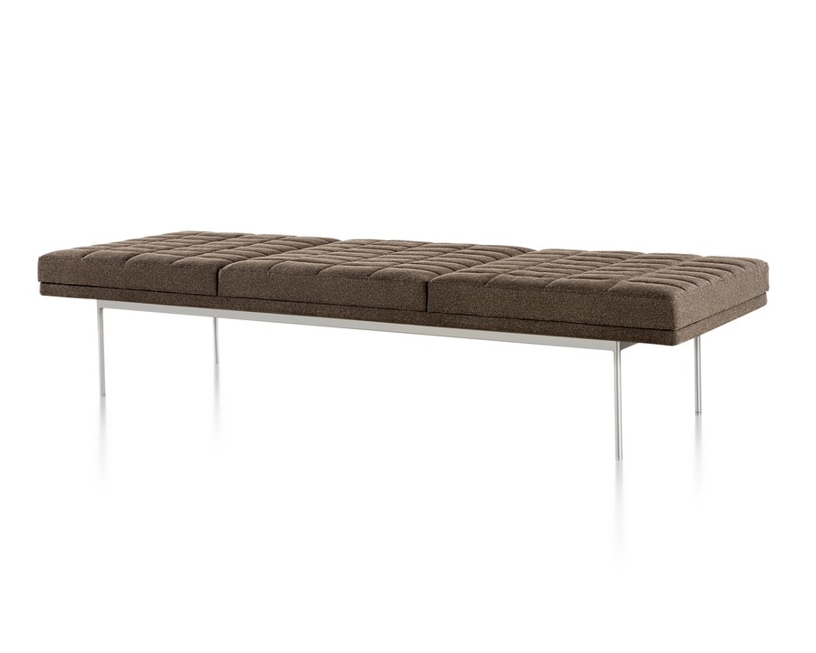 Tuxedo Bench with brown quilted upholstery and satin chrome base.
