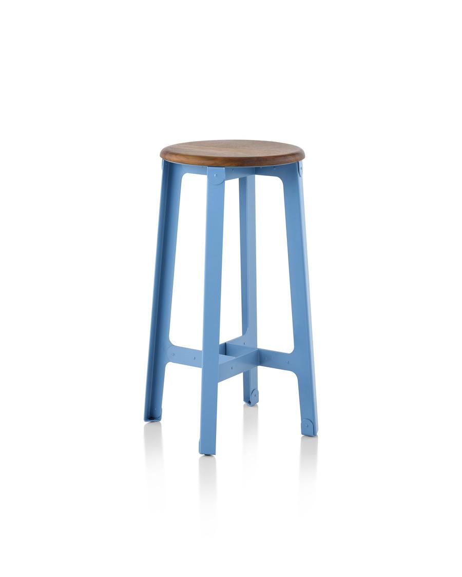 A bar height blue naughtone Construct Stool.