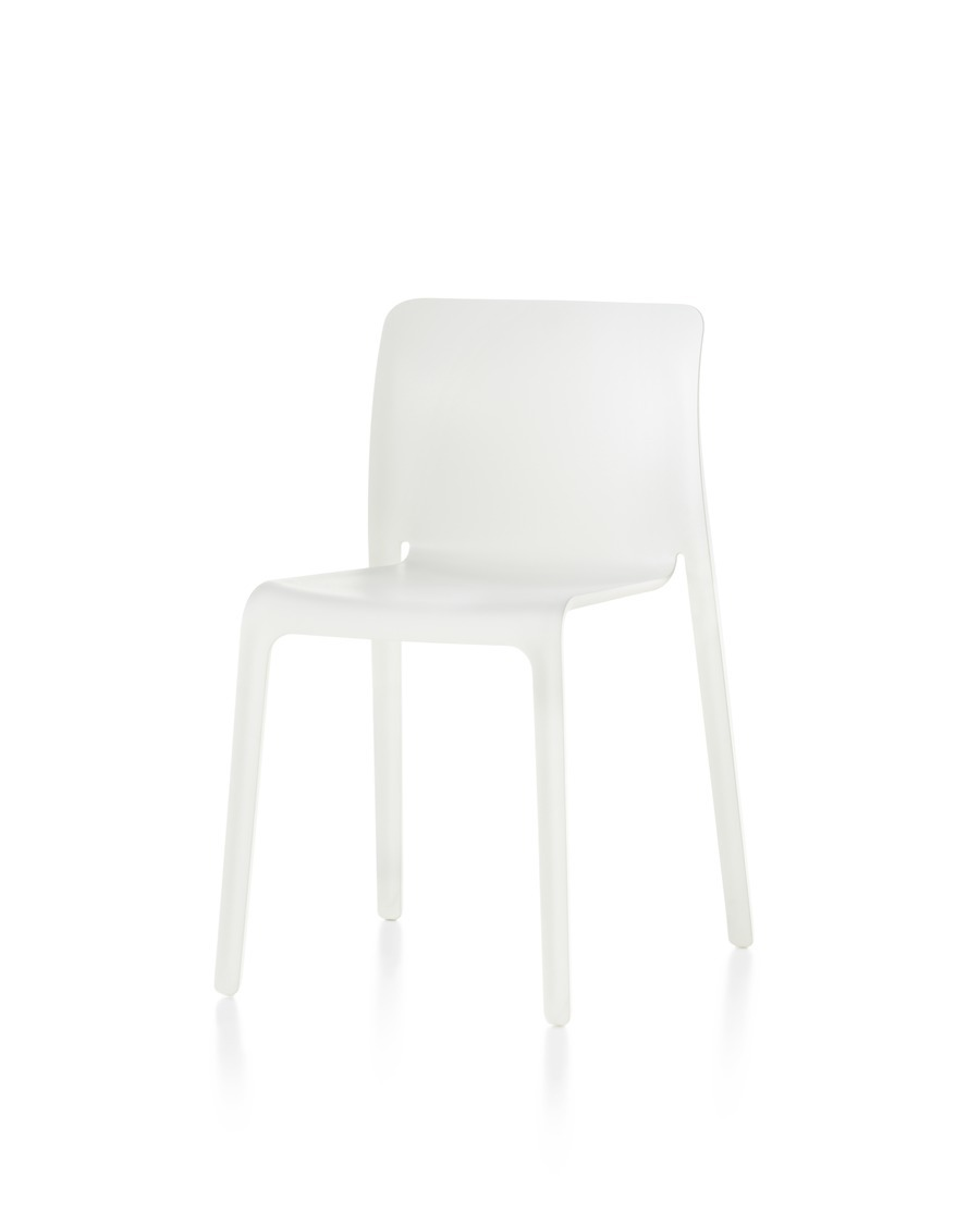 White Magis Chair First plastic stacking chair, viewed from a 45-degree angle.