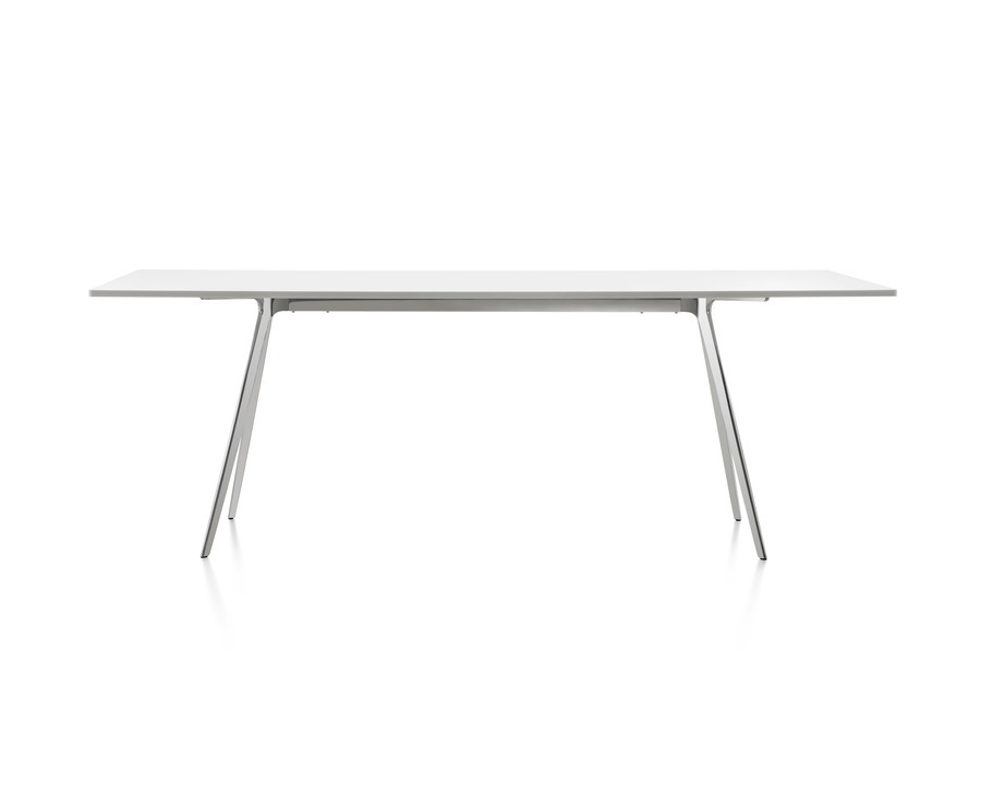 Magis Baguette Table with a white glass top and white painted cast aluminum legs in angled view.