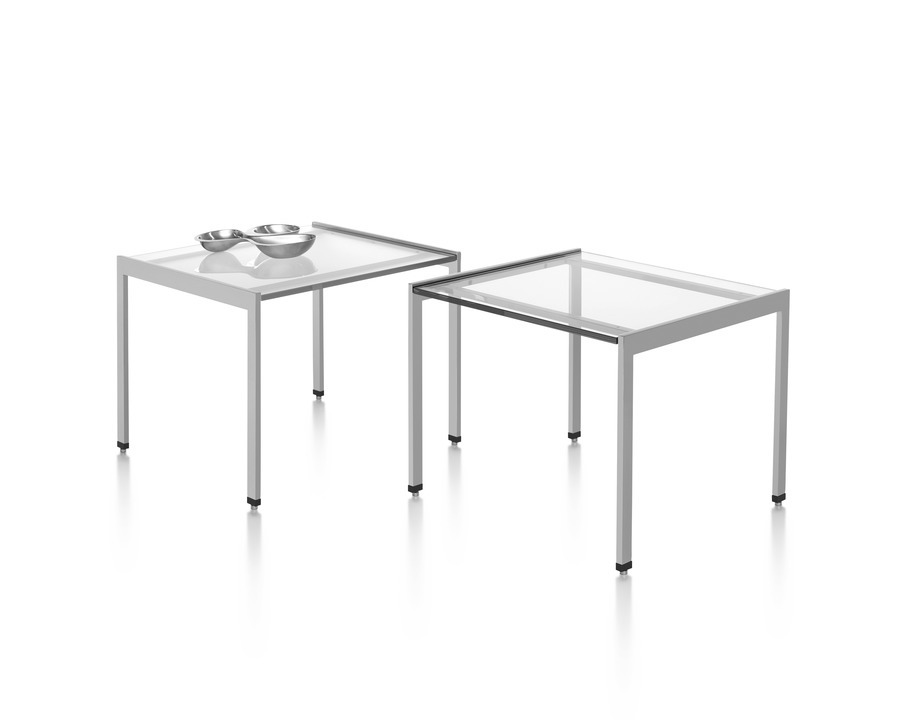 Two H Frame side tables with glass tops.