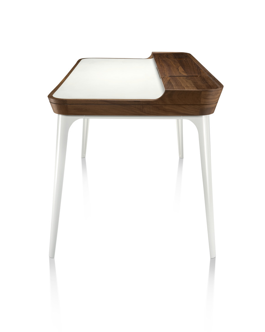 Modern Airia home office desk from Herman Miller in white with dark wood trim and white legs in side view