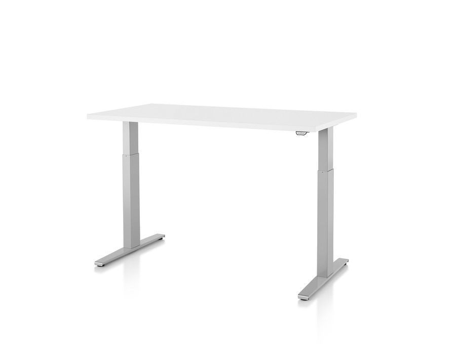 A white Motia Sit-to-Stand Table, viewed from a 45-degree angle.
