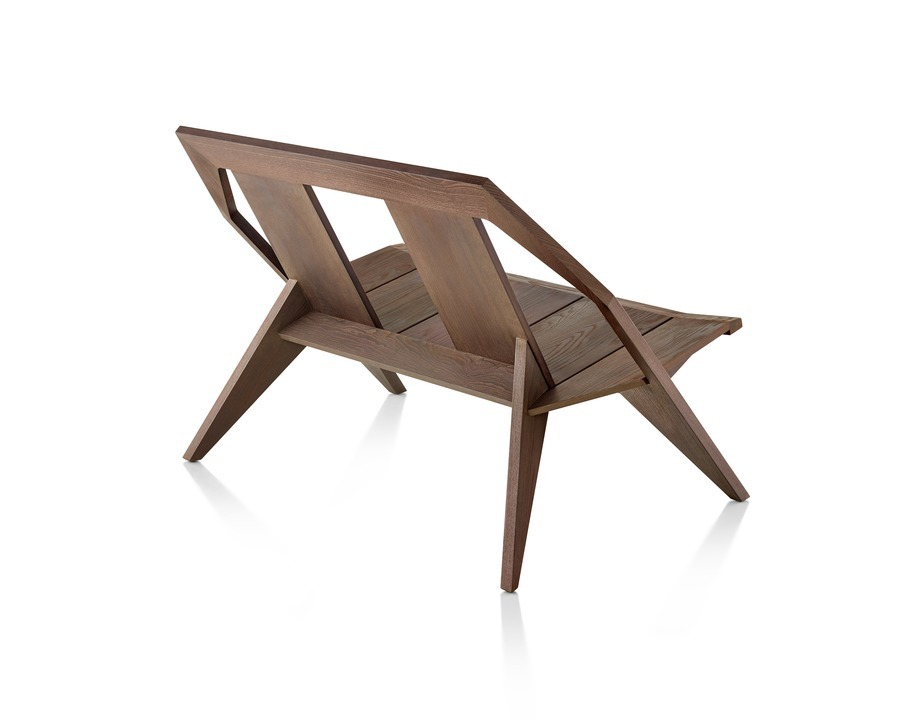 Three-quarter rear view of a wood Mattiazzi Medici two-seat outdoor bench in a medium finish.