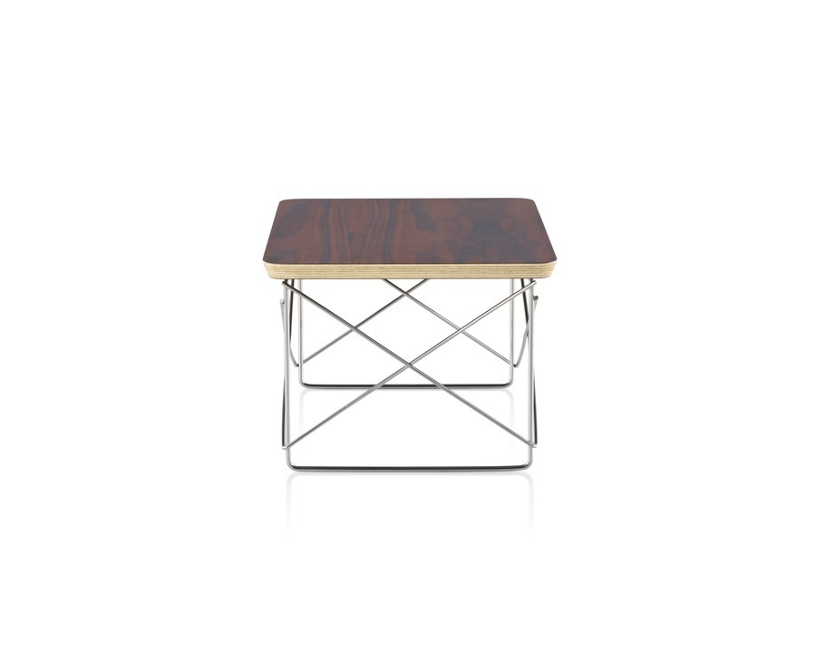 An Eames Wire Base Low Table with a medium wood finishveneer top