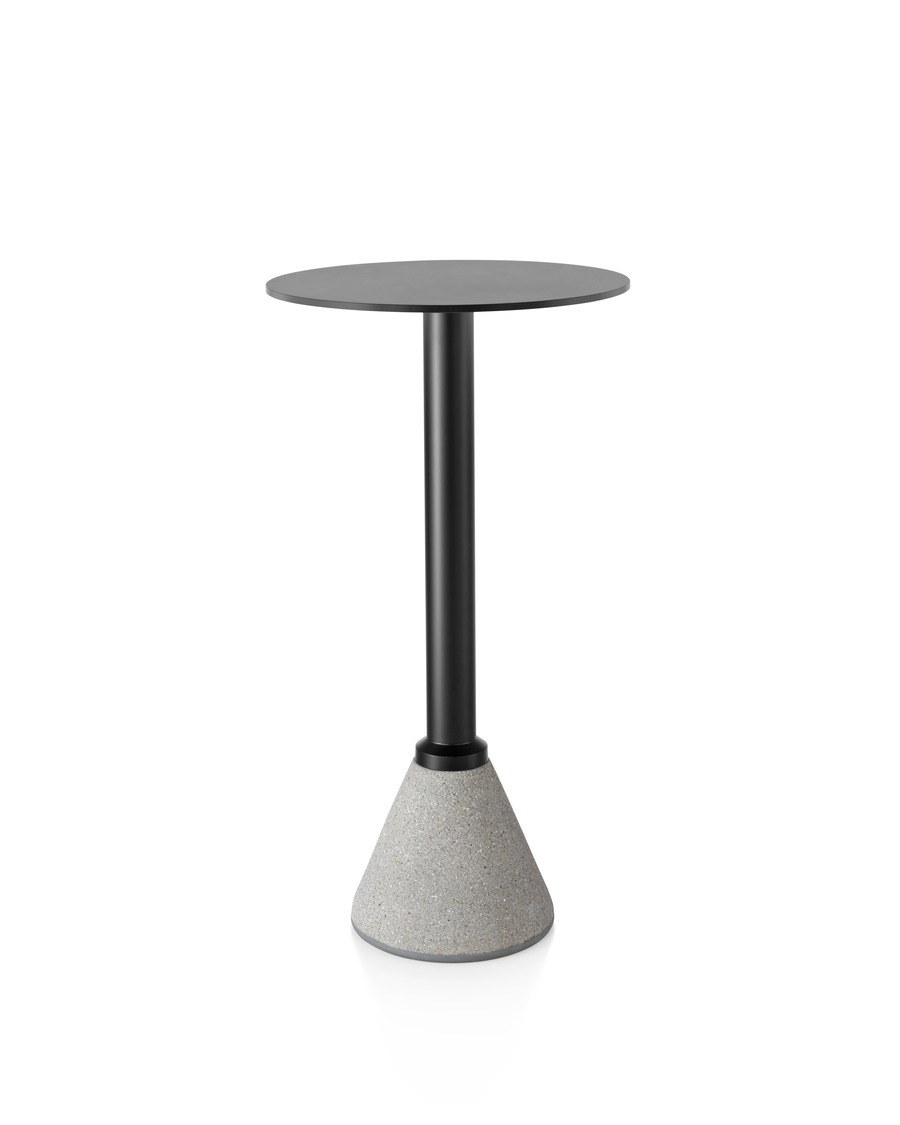 A Magis Table_One Bistro table with a black top, black frame, and concrete base.